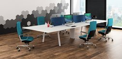 Green Liven medium back office chairs complement a back-to-back benching setup.