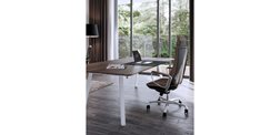 Brown leather Liven office chair with Klug table in white leg finish and woodgrain top.
