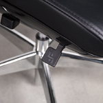 Close-up of the seat height lever of a Liven leather office chair.