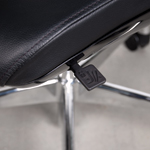 Close-up of the tilt-lock lever of a Liven leather office chair.